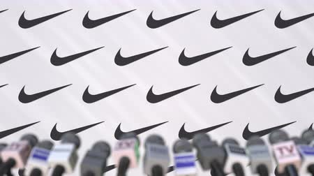 dekking : NIKE company press conference, press wall with logo and mics, conceptual editorial animation