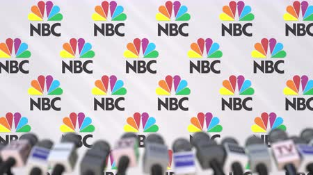 press wall : Press conference of NBC, press wall with logo and microphones, conceptual editorial animation Stock Footage