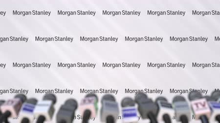 duyuru : Press conference of MORGAN STANLEY, press wall with logo and microphones, conceptual editorial animation