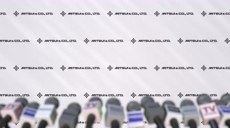 утверждение : Press conference of MITSUI, press wall with logo and microphones, conceptual editorial animation Стоковые видеозаписи