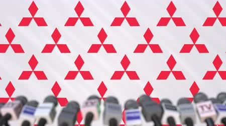 редакционный : News conference of MITSUBISHI, press wall with logo as a background and mics, editorial animation Стоковые видеозаписи
