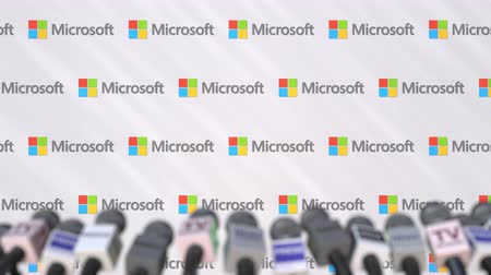 declaring : News conference of MICROSOFT, press wall with logo as a background and mics, editorial animation Stock Footage