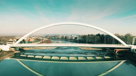 voar : ALESSANDRIA, ITALY - JANUARY 4, 2019. Aerial view of modern Ponte Meier bridge over the Tanaro river Stock Footage