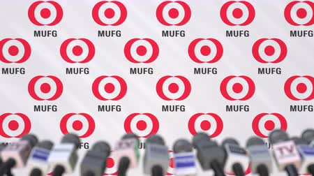 press wall : Mitsubishi UFJ Financial Group company press conference, press wall with logo and mics, conceptual editorial animation