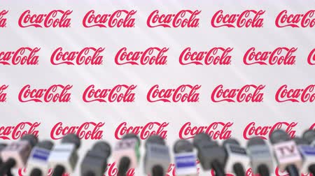 press wall : News conference of COCA-COLA company, press wall with logo as a background and mics, editorial animation