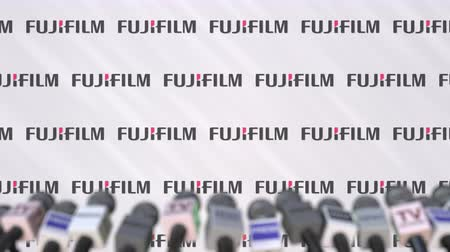 press wall : Media event of FUJIFILM, press wall with logo and microphones, editorial animation