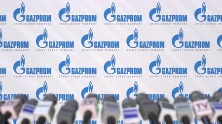 gazprom : News conference of GAZPROM, press wall with logo as a background and mics, editorial animation