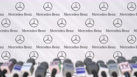 press wall : Press conference of MERCEDES-BENZ company, press wall with logo and microphones, conceptual editorial animation