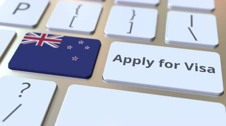 consulate : APPLY FOR VISA text and flag of New Zealand on the buttons on the computer keyboard. Conceptual 3D animation Stock Footage