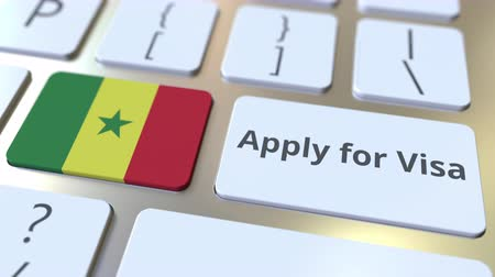 виза : APPLY FOR VISA text and flag of Senegal on the buttons on the computer keyboard. Conceptual 3D animation Стоковые видеозаписи