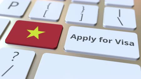 vietnã : APPLY FOR VISA text and flag of Vietnam on the buttons on the computer keyboard. Conceptual 3D animation