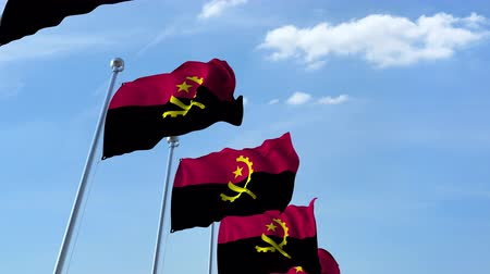 flaga : Row of waving flags of Angola agaist blue sky, seamless loop