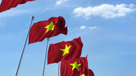 vietnami : Row of waving flags of Vietnam agaist blue sky, seamless loop Stock mozgókép