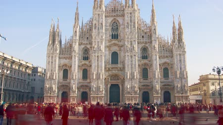 uzun boylu : Long exposure time lapse of Duomo di Milano or Milan Cathedral, main landmark in the centre of the city, Italy Stok Video