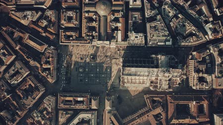 point of interest : Aerial top-down shot of crowded square and the Cathedral or Duomo in the centre of Milan. Lombardy, Italy