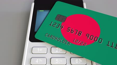 fizetés : Payment terminal with credit card featuring flag of Bangladesh. Bangladeshi national banking system conceptual 3D animation Stock mozgókép