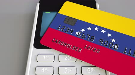 payment terminal : Payment terminal with credit card featuring flag of Venezuela. Venezuelan national banking system conceptual 3D animation
