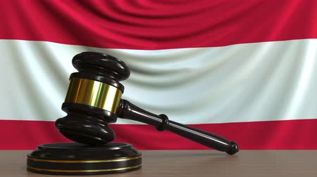 licit : Judges gavel and block against the flag of Austria. Austrian court conceptual animation