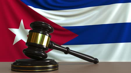 licit : Judges gavel and block against the flag of Cuba. Cuban court conceptual animation