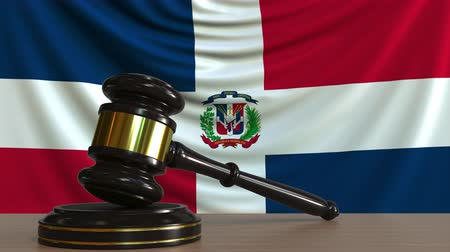 licit : Judges gavel and block against the flag of the Dominican Republic. National court conceptual animation
