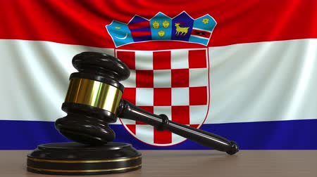 licit : Judges gavel and block against the flag of Croatia. Croatian court conceptual animation