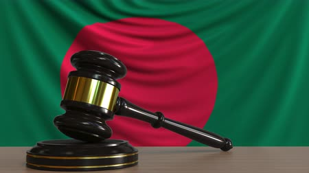 licit : Judges gavel and block against the flag of Bangladesh. Bangladeshi court conceptual animation
