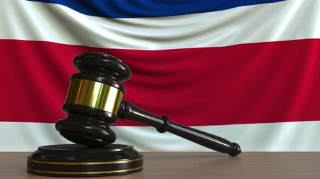 licit : Judges gavel and block against the flag of Costa Rica. National court conceptual animation