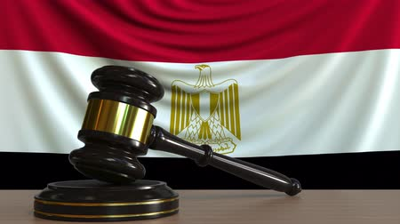 licit : Judges gavel and block against the flag of Egypt. Egyptian court conceptual animation