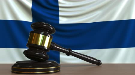 licit : Judges gavel and block against the flag of Finland. Finnish court conceptual animation