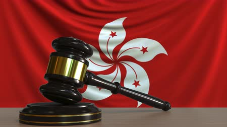 licit : Judges gavel and block against the flag of Hong kong. Court conceptual animation Stock Footage