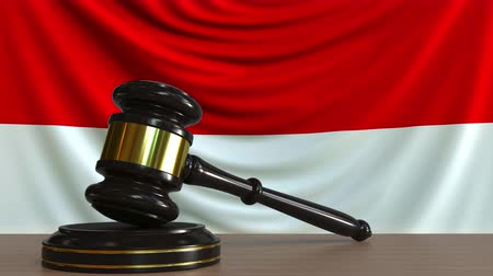 licit : Judges gavel and block against the flag of Indonesia. Indonesian court conceptual animation