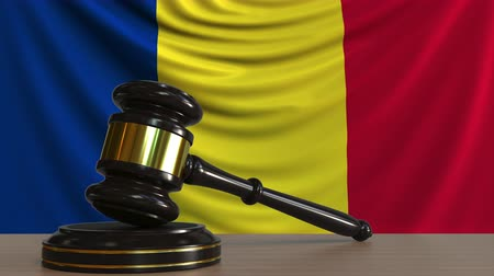 szabály : Judges gavel and block against the flag of Romania. Romanian court conceptual animation