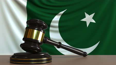licit : Judges gavel and block against the flag of Pakistan. Pakistani court conceptual animation