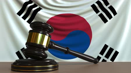 licit : Judges gavel and block against the flag of South Korea. Korean court conceptual animation