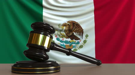 licit : Judges gavel and block against the flag of Mexico. Mexican court conceptual animation