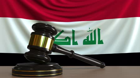 licit : Judges gavel and block against the flag of Iraq. Iraqi court conceptual animation Stock Footage