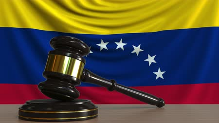 licit : Judges gavel and block against the flag of Venezuela. Venezuelan court conceptual animation Stock Footage