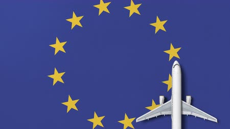 flat lay : Commercial airplane on the flag of the European Union EU. Travel related conceptual 3D animation