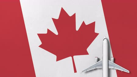 kanada : Top-down view of the airplane on the flag of Canada. Tourism related conceptual 3D animation