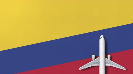 colômbia : Airplane on the flag of Colombia. Flights related conceptual 3D animation Vídeos
