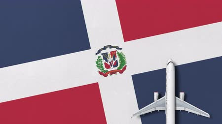 dominican : Commercial plane on the flag of Dominican republic. Tourism related conceptual 3D animation Stock Footage
