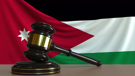 licit : Judges gavel and block against the flag of Jordan. Jordanian court conceptual animation