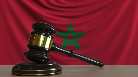 licit : Judges gavel and block against the flag of Morocco. Moroccan court conceptual animation