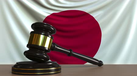 istek : Judges gavel and block against the flag of Japan. Japanese court conceptual animation