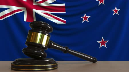 licit : Judges gavel and block against the flag of New Zealand. Court conceptual animation