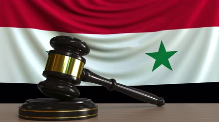 судья : Judges gavel and block against the flag of Syria. Syrian court conceptual animation Стоковые видеозаписи