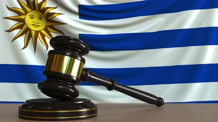 licit : Judges gavel and block against the flag of Uruguay. Uruguayan court conceptual animation