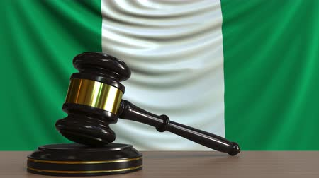 licit : Judges gavel and block against the flag of Nigeria. Nigerian court conceptual animation
