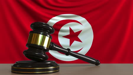 licit : Judges gavel and block against the flag of Tunisia. Tunisian court conceptual animation