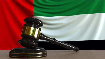 gabela : Judges gavel and block against the flag of the United Arab Emirates. UAE court conceptual animation